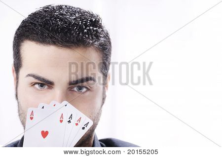 Portrait Of Man With Poker Cards On White Background
