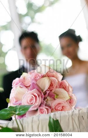 bride and groom blurred behind their bouquet