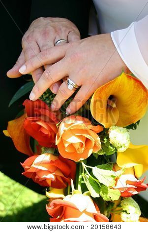 wedding detail with hands and flowers