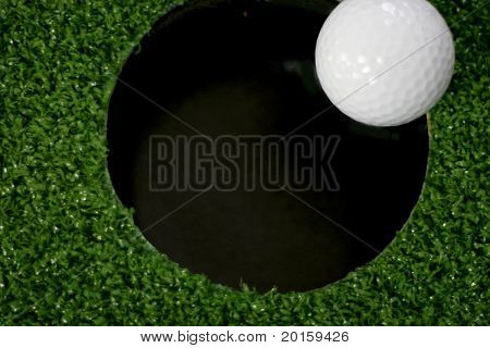 golf ball tipping in the hole