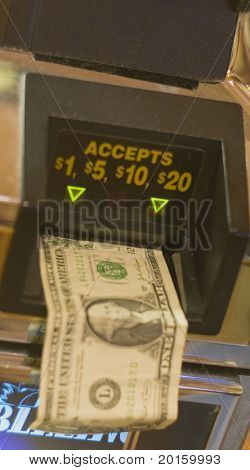 money going into slot machine
