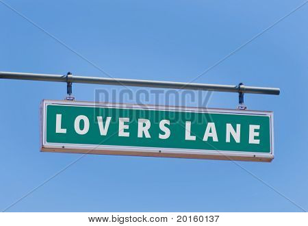 lovers lane sign on bright blue sky