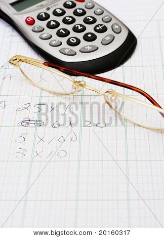 calculator and glasses plus pad