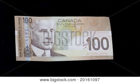 100 canadian bill on black