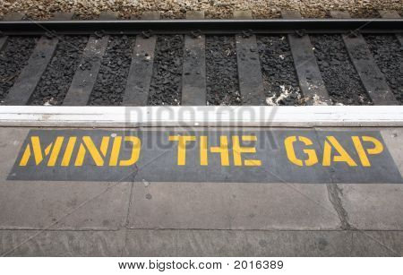 Mind The Gap Sign On A British Railway Platform.