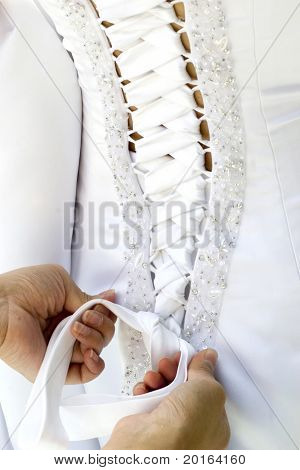 wedding gown being tied up at back great detail closeup