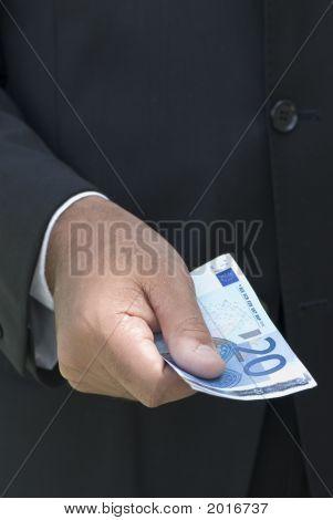 Businessman Holding Euro