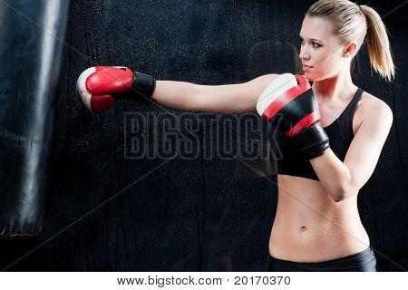 Boxing Training Woman In Gym Punching Bag