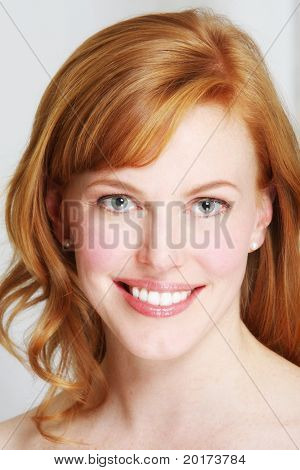 a fresh faced redhead with a beautiful smile