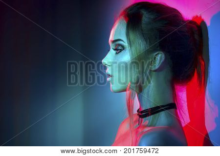 poster of High Fashion model woman in colorful bright lights posing, portrait of beautiful sexy girl with tren