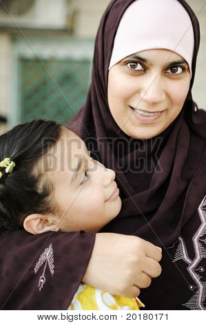 Muslim arabic mother with her  daughter, love and care