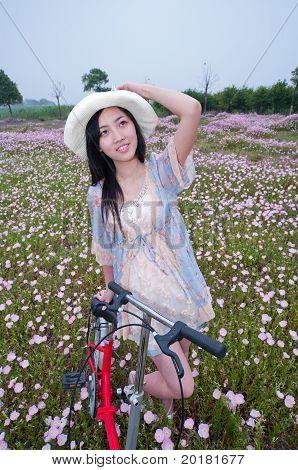 Girl In Garden With Bike