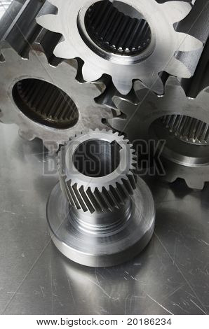 gear-axel and three cog-wheels