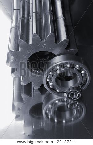 oblong gears and ball-bearings reflecting in titanium