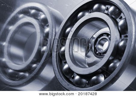 ball-bearings in bluish cast reflecting in titanium