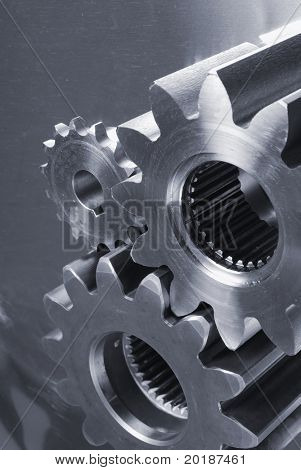 different gears connecting against stainless-steel