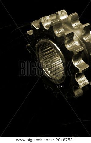 large double-gears against black velvet