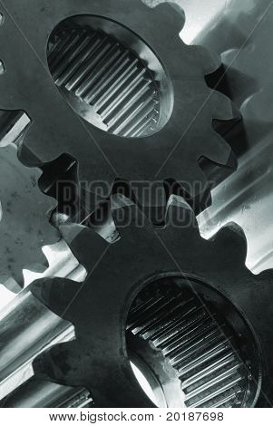 three gears in slight greenish cast, against the light shot