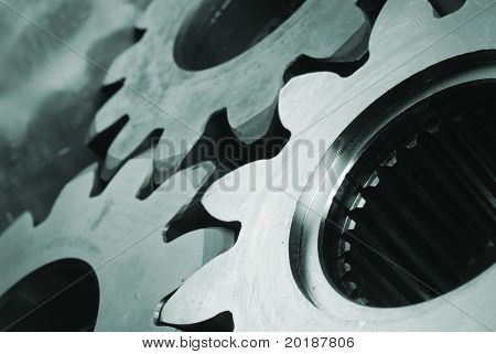large gears in close-up in a greenish cast