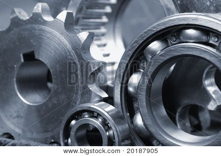 close-up of gears and bearings with large pinion in background