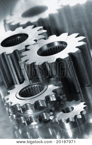 large gear-machinery against shiny titanium