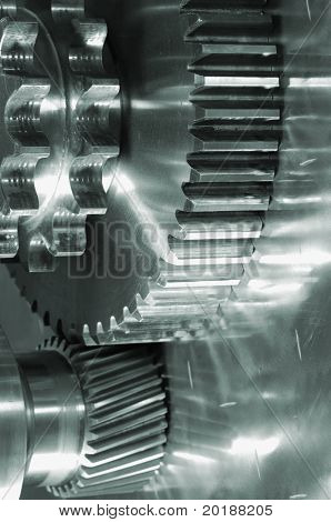 gear-machinery concept against titanium, all in a green metallic tone