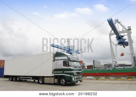 truck, lorry waiting for load from crane in port