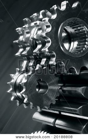 gears and mirror reflection idea in dark metallic toning