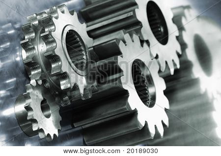 gear machinery in light green against titanium background in blue toning