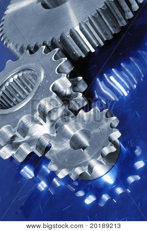 gear machinery reflecting in deep blue steel, dual color concept