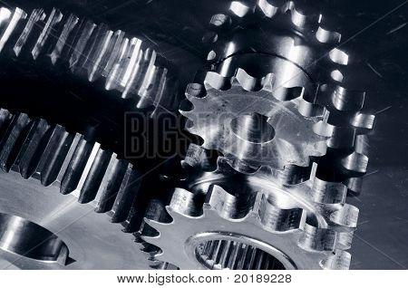 gear parts mirrored in steel, all in a dark satin duplex toning