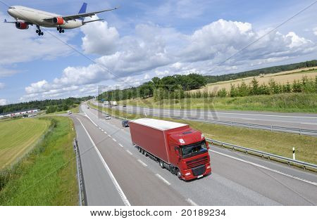 transport concept, by air and land, truck and  over-sized airliner