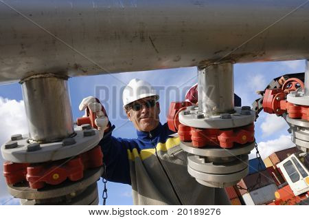 engineer turning pipelines, photographed from underneath