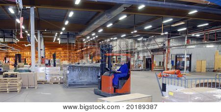 large warehouse interior with forklifts and packages