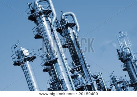 oil and gas refinery in a blue metallic toning concept, tilted perspective