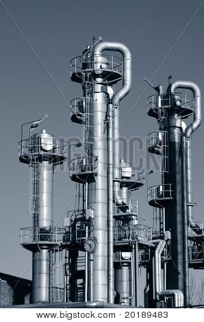 oil and gas refinery towers and pipelines, all in a duplex bluish toning idea
