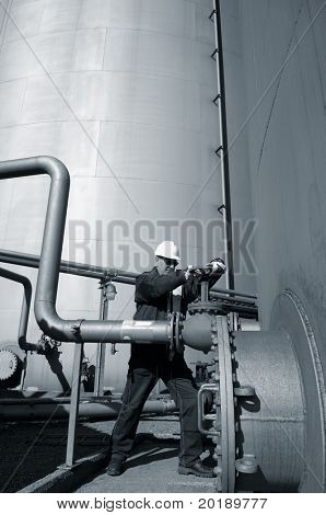 engineer, pipelines, pumps and oil-storage, all in a bluish toning idea