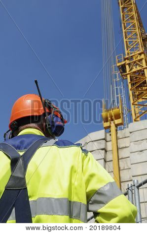 construction engineer in front of mobile crane
