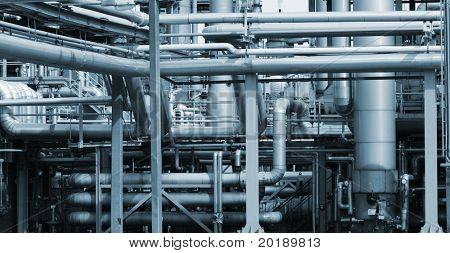 panoramic view of oil and gas industry, pipelines and pumps, blue toning idea.