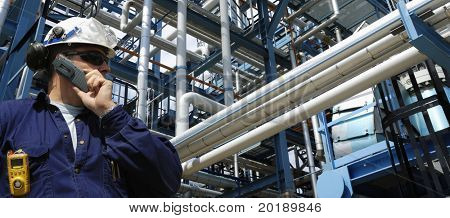 oil and gas and pipelines with engineer talking in phone., panorama