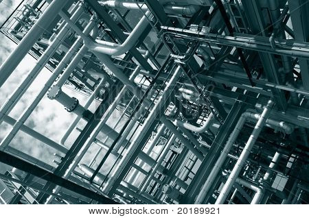 large pipeline construction inside oil and gas refinery