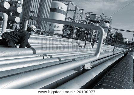 engineer with giant pipeline construction, blue toning idea