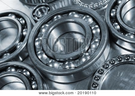 large ball-bearing concept against steel, close-ups and in a blue toning idea
