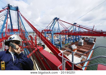 engineer overlooking busy container-port