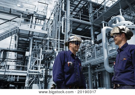 engineers working in chemical-plant, blue toned background