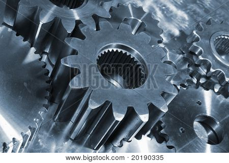 titanium and steel concept with industry gears, blue toning