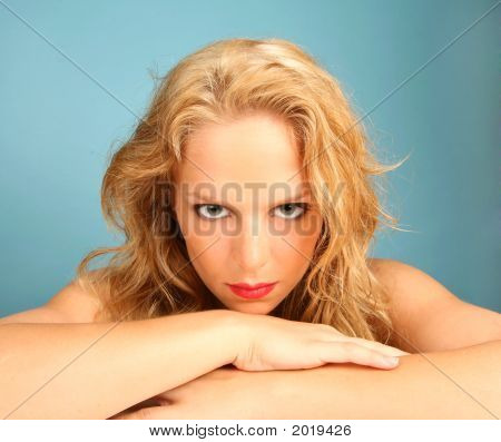 Stare Of A Beautiful Woman On Blue Background
