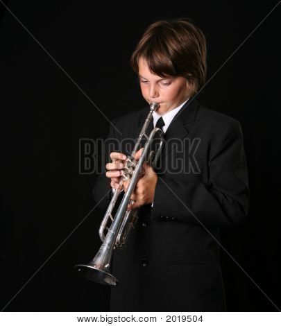Teenager Playing The Trumpet