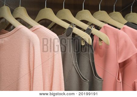 Colorful collection of women's clothes hanging on a rack