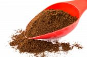 Ground Coffee In Red Spoon And Heap Of Coffee poster